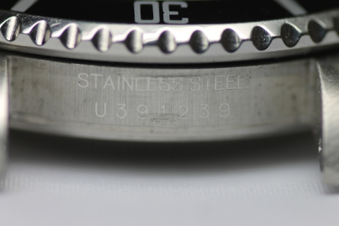 Reference/serial numbers of Rolexes are found between the lugs